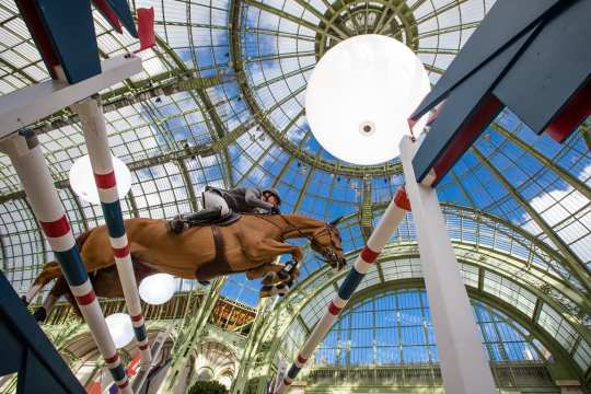 First place: Photographer: Eric Knoll. Philipp Weishaupt jumping over an obstacle in the Grand Palais in Paris.